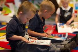 Preschool_Boy_Reading_a_Book.jpg